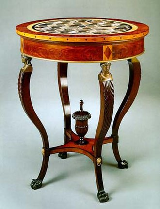 Guéridon - A c. 1810 guéridon by French-born American cabinetmaker Charles-Honoré Lannuier. Mahogany, satinwood, rosewood, and possibly sycamore veneers, gilded brass, and marble. Located in the Red Room of the White House.