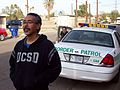 Ricardo Dominguez and Border Patrol Agent, Calexico, California 2009.jpg