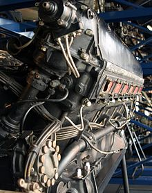 A rear view of the right side of an aircraft piston engine with details of pipes and electrical wiring