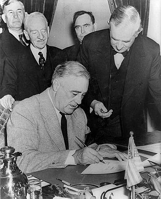 Tom Connally - Connally (next to Roosevelt) holding a watch to fix the exact time of the declaration of war against Germany (3:05 PM E.S.T. on 11 December 1941)