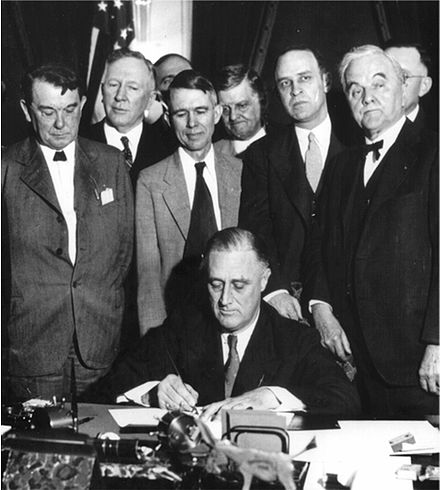 President Franklin D. Roosevelt signs the TVA Act Roosevelt signing TVA Act (1933).jpg