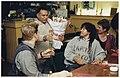 Rozenman Surinder Singh verkoopt in Restaurant 'De Karmeliet' in de Spekstraat enkele rozen aan judoka Dennis van der Geest. Midden theaterman Hakim Traidia, NL-HlmNHA 54037106.JPG