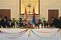 S.M. Krishna and the Member of Parliament, Minister of Foreign Affairs and Trade of Mongolia, Mr. Sukhbaataryn Batbold signing the agreements on Stabilization Loan Assistance, in the presence of the Prime Minister.jpg