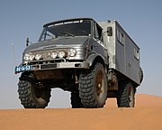 Mercedes-Benz Unimog in the Dunes of Erg Chebbi in Morocco. Note the high ground clearance due to Portal gear axles