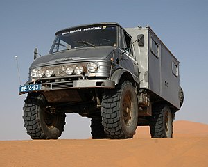 Off-road vehicle - Mercedes-Benz Unimog in the Dunes of Erg Chebbi in Morocco. Note the high ground clearance due to portal gear axles.