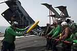Sailors extend tail of MH-60R Sea Hawk helicopter 130615-N-LP801-166.jpg
