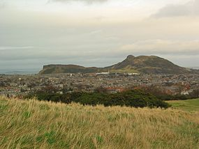 Salisbury Crags and Arthur's Seat in Edinburgh.jpg