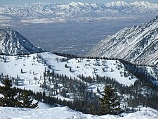 Looking down and westward at the city and the Oquirrh Mountains from Snowbird Ski Resort in the Wasatch Range of the Rocky Mountains.