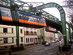 Elevated railway - Two Wuppertal Schwebebahn trains meet above street