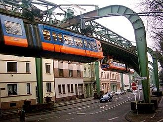 Elevated railway - Two Wuppertal Schwebebahn trains meet above street