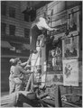 Second Liberty Loan, October 1917. Fattie Arbuckle, the movie star, putting up a Liberty Loan poster at Times Square, Ne - NARA - 533663.tif