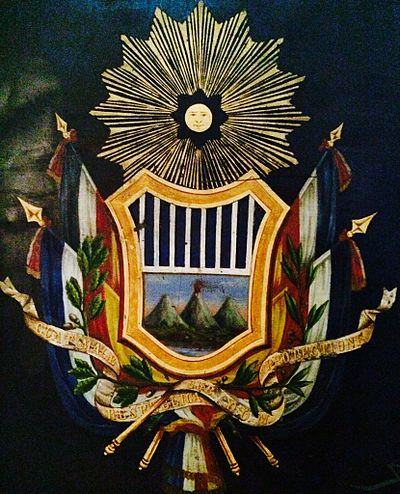 Coat of Arms of the Republic of Guatemala between 1858 and 1871. A replica was carved on the front side of the Carrera theater before it was remodeled in 1892. Segundoescudoguate 2014-06-22 09-16.jpg
