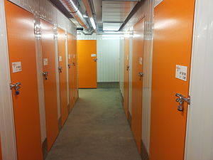 Self storage - Inside a self-storage facility, with a rollup door (left) and a hinged door