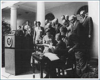 Wilderness Act - President Lyndon Johnson signs the Wilderness Act of 1964 in the White House Rose Garden.  Also pictured are Interior Secretary Stewart Udall, Senator Frank Church, Mardy Murie, Alice Zahniser, and Representative Wayne Aspinall, among others.