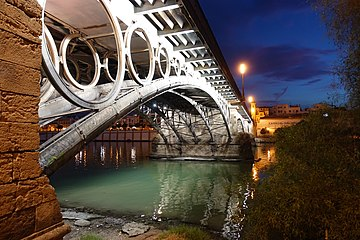 Sevilla triana bridge underside night.jpg