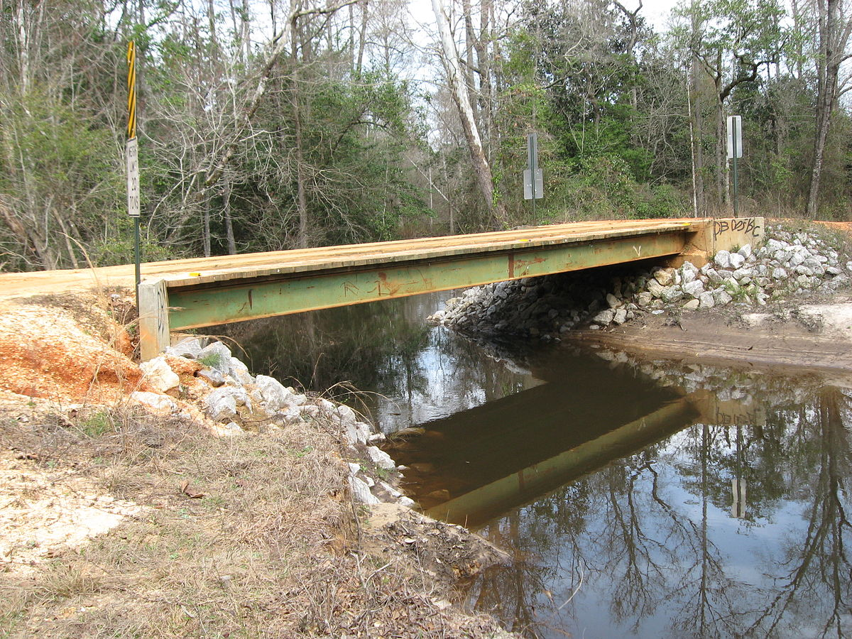 File Side View Of Wooden Bridge Over Creek Near Burnt