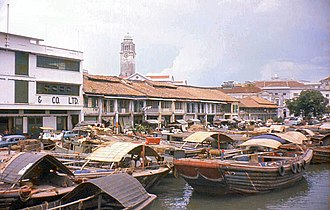 Singapore - Singapore thrives as an entrepot. Bumboats used to transport cargoes and supplies between nearshore ships and Singapore River, c.1960