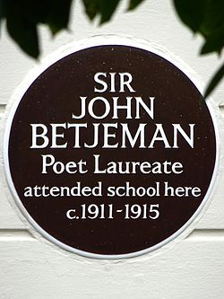 Photo of John Betjeman brown plaque