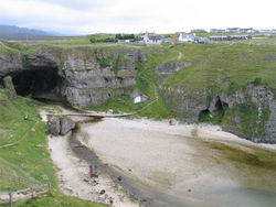 Durness with Smoo Cave; the youth hostel is up on the right.
