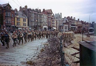 Invasion of Normandy - U.S. soldiers march through Weymouth, Dorset, en route to board landing ships for the invasion of France.