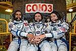 Soyuz MS-15 crew members in front of their spacecraft.jpg