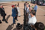 Soyuz MS-15 prime crew members report to Russian space officials at Krayniy Airport.jpg