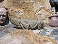 Stone grasshopper Gilgal garden 3.JPG