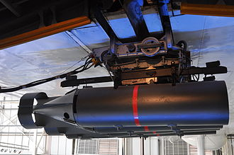 Depth charge - Depth bombs hang under the wings of an RAF Short Sunderland flying boat on display in the RAF Museum, Hendon