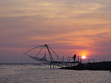 Sunset and chineese net at munambam beach.jpg