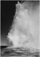 "Taken at dusk or dawn from various angles during eruption. ""Old Faithful Geyser, Yellowstone National Park,"" Wyoming. (v - NARA - 520016.tif"