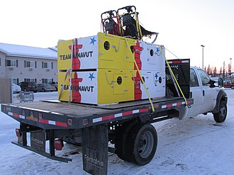 Flatbed truck - A modern flatbed with an unusual load, held down by webbing ratchet straps