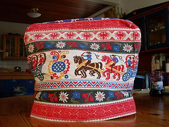 Tea cosy - A traditional German tea cosy made of quilted fabric with folk art patterns