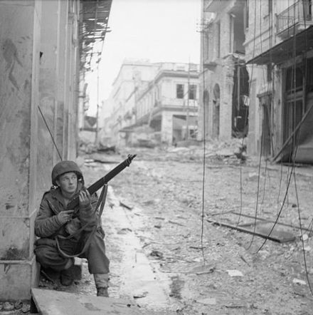 A soldier from the 5th (Scottish) Parachute Battalion takes cover in Athens during the Dekemvriana events, 18 December 1944 The British Army in Greece 1944 NA20863.jpg