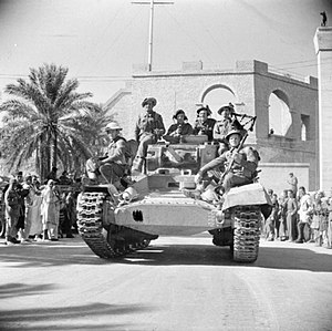 Douglas Wimberley - A piper of the 1st Battalion, Gordon Highlanders plays from a Valentine tank as it drives into Tripoli past crowds of cheering locals, 26 January 1943.