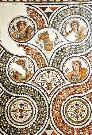 Season - The four calendar seasons, depicted in an ancient Roman mosaic from Tunisia.