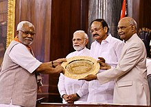 The President, Shri Ram Nath Kovind presenting the Outstanding Parliamentarian Award for the year 2014 to Shri Hukmdev Narayan Yadav, at a function, at Parliament House, in New Delhi.JPG