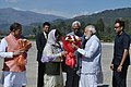 The Prime Minister, Shri Narendra Modi being received by the Governor of Jammu and Kashmir, Shri N.N. Vohra and the Chief Minister of Jammu and Kashmir, Ms. Mehbooba Mufti, on his arrival, in Jammu and Kashmir.jpg
