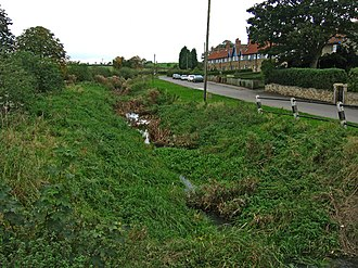 Garthorpe, Leicestershire - The River Eye in front of a terrace of cottages in Garthorpe photographed in October 2005