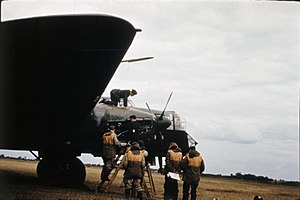 RAF Middleton St George - A crew of No. 78 Squadron RAF watch as engine adjustments are made to an Armstrong Whitworth Whitley bomber, Z6743, before they take off for a raid from Middleton St George.
