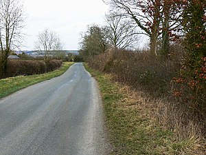 English: The road to the A3102, west of Wootto...