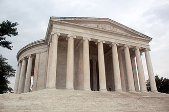 The monument's marble steps, portico, and circular colonnade of Ionic order columns, and shallow dome. Thomas-jefferson-memorial-front-view.jpg