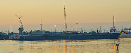 A tugboat pushes a barge at the Port of Tampa. Tugboat pushes a barge at Port of Tampa.jpg