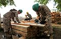 U.S. Marine Corps Lance Cpl. Taylor Tingey, left, and Lance Cpl. Bennett Russ, right, combat engineers with the 9th Engineer Support Battalion, 3rd Marine Logistics Group, measure lumber while Army Spc 130722-M-MG222-003.jpg
