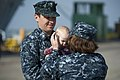 U.S. Navy Counselor 1st Class Drew Cyvas, left, hands his daughter to his wife, Navy Counselor 1st Class Rena Cyvas, May 14, 2013, before departing from Naval Base San Diego aboard the amphibious dock landing 130514-N-SK590-075.jpg