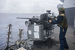 U.S. Navy Gunner's Mate 2nd Class Ashley Cordray fires a Mark 38 25 mm machine gun aboard the guided missile destroyer USS Preble (DDG 88) in the Pacific Ocean during a live-fire weapons shoot June 19, 2013 130619-N-TX154-384.jpg