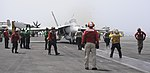 U.S. Sailors prepare an F-A-18C Hornet aircraft assigned to Strike Fighter Squadron (VFA) 146 for launch from the aircraft carrier USS Nimitz (CVN 68) in the Indian Ocean June 11, 2013 130611-N-TI017-058.jpg