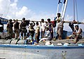USS Mason (DDG 87) VBSS team greet the crew of a Yemeni fishing dhow.jpg