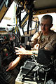 US Army 52963 BAGHDAD- Sgt. Abraham Kay, a motor pool maintenance squad leader, from Coleman, Texas, points to the mode panel on the transmission control module inside a Mine-Resistant Ambush-Protected vehicle, her.jpg