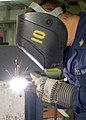 US Navy 020724-N-1280S-002 Welder works aboard ship.jpg