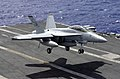 US Navy 030322-N-2143T-002 An F-A-18F Super Hornet prepares to make an arrested landing.jpg